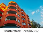 Red Corner Building With Big...