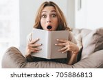 Shocked Young Woman With Book...