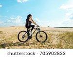 woman cyclist carrying mountain ... | Shutterstock . vector #705902833