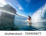 muscular surfer riding on big...   Shutterstock . vector #705909877