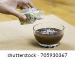 pouring rainbow sprinkles on... | Shutterstock . vector #705930367