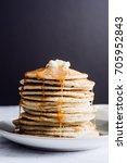 a tall stack of golden pancakes ... | Shutterstock . vector #705952843