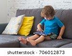 little cute boy in a blue t... | Shutterstock . vector #706012873