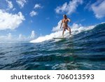 muscular surfer riding on big... | Shutterstock . vector #706013593