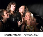 group of women singing karaoke | Shutterstock . vector #706028557