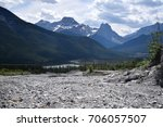 Small photo of a landscape of a rocky picnic area with the Canadian Rockies in the background