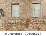 fences and walls of houses are... | Shutterstock . vector #706086217