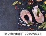steak of white fish on a black... | Shutterstock . vector #706090117