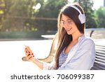 cute girl with headphones and... | Shutterstock . vector #706099387