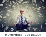business man meditating under... | Shutterstock . vector #706101307