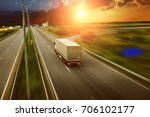 white truck driving fast with... | Shutterstock . vector #706102177