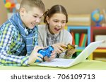 brother and sister playing... | Shutterstock . vector #706109713