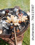 Small photo of Smoked lard (Slanina), sausages and bread cooked on fire. Cooking in the nature. Romanian traditional food.