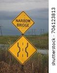 Small photo of narrow bridge sign