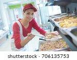 buffet female worker servicing...   Shutterstock . vector #706135753