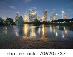 Small photo of Reflection of Downtown Houston skyscrapers on a pond of overflow water from Bayou River to Eleanor Park after Harvey tropical storm. Heavy rain of hurricane Harvey caused many flooded areas in Houston