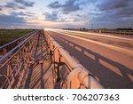 highway traffic in sunset  | Shutterstock . vector #706207363