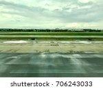 airport runway is wet by... | Shutterstock . vector #706243033