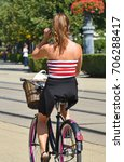 woman with bicycle in the city | Shutterstock . vector #706288417