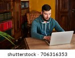 the guy sitting at the table... | Shutterstock . vector #706316353