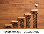 Small photo of wooden staircase to reach goal and winning flag with increase graph and arrow, successful