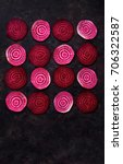 Small photo of Sliced beetroot arrange in pattern on dark background. Top view with copy space