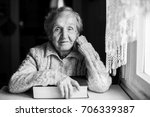 an elderly woman with a closed... | Shutterstock . vector #706339387