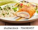 Small photo of Fired cordon bleu chicken served with rice and parsley on plate
