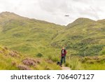 man in highlands mountains in... | Shutterstock . vector #706407127