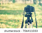 camera on tripod in nature  the ... | Shutterstock . vector #706411033