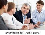 a senior businessman talking to ... | Shutterstock . vector #70641598