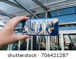 Small photo of NEW YORK, AUGUST 2017 - Samsung Galaxy Note 8 smartphone is displayed with a reflection of New York city skyline. Focus on reflection.