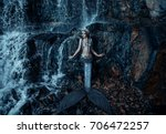 the real mermaid is resting on... | Shutterstock . vector #706472257