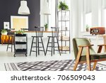 rustic green chair on black and ... | Shutterstock . vector #706509043