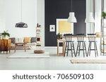 black bar stools at countertop... | Shutterstock . vector #706509103