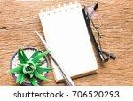 office desk with glasses ... | Shutterstock . vector #706520293