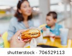 mother and her son having a... | Shutterstock . vector #706529113