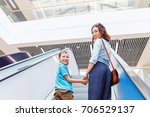 mother and her son on escalator ... | Shutterstock . vector #706529137