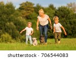 picture of a mother with two... | Shutterstock . vector #706544083