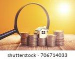 concept of a mortgage  a coin ...   Shutterstock . vector #706714033