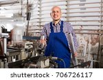 smiling middle aged worker in... | Shutterstock . vector #706726117