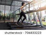 fitness woman running on... | Shutterstock . vector #706833223