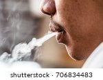 smoke from his mouth   smoke... | Shutterstock . vector #706834483