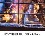 on christmas night a little boy ... | Shutterstock . vector #706915687