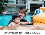 the kid and mom play together... | Shutterstock . vector #706943737