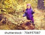 little girl in the autumn... | Shutterstock . vector #706957087