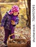 little girl in the autumn... | Shutterstock . vector #706957093