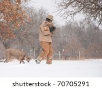 Man Carrying Firewood Bundled...