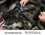 the mechanic fixes the vehicle... | Shutterstock . vector #707073313