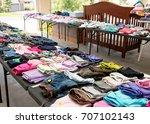 garage sale tables with clothing | Shutterstock . vector #707102143